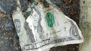burned money by califrayfray on Flickr