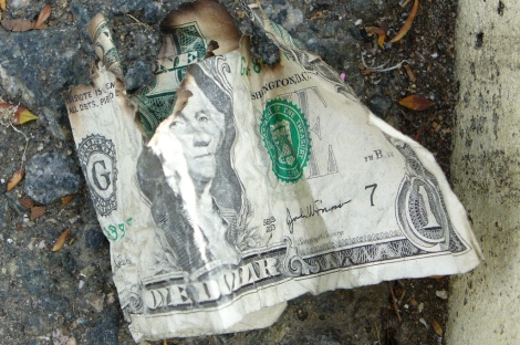 burned money by califrayfray on Flickr